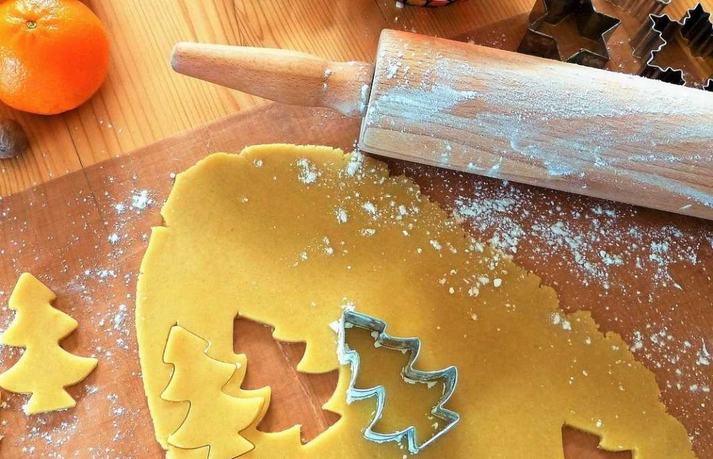 using biscuit cutter on dough